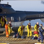 North Sea Oil Workers Disembark Helicopter To Platform