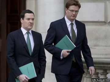 UK Chancellor of the Exchequer George Osborne and Chief Secretary to the Treasury Danny Alexander leave the Treasury in central London