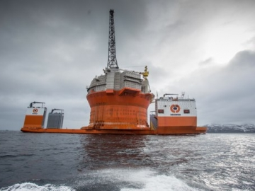 ENI's Goliat Cylindrical FPSO Onboard The Heavy Lift Semisubmersible Ship Dockwise Vanguard