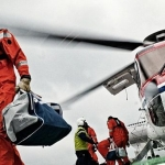 Workers Arrive By Helicopter At An Offshore Platform
