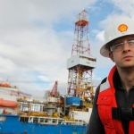 Shell Worker Next To Offshore Drill Ship Noble Discoverer, Offshore Alaska