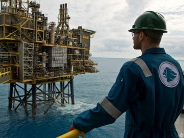 An Expro Offshore Worker Looks On A UK North Sea Oil Platform