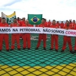 Brazilian Offshore Oil And Gas Workers Standing On An Offshore Platform Helideck Protesting Over Petrobras Corruption