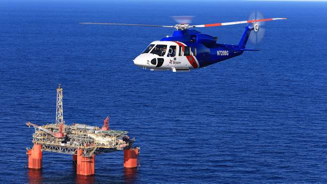 A Bristows Operated S-76 Offshore Helicopter Flying From An Oil Rig