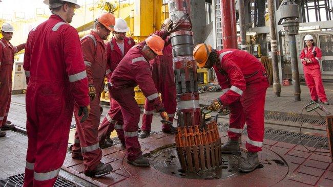 ExxonMobil Offshore Drill Crew On Drillfloor