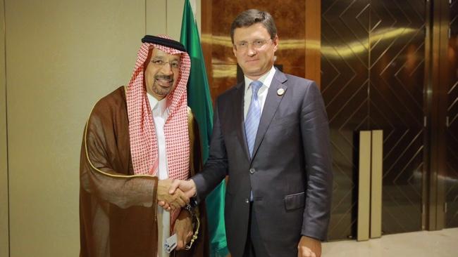 Saudi Oil Minister Khalid Al Falih Shakes Hands With Russian Counterpart Alexander Novak